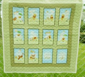 pooh storybook baby quilt